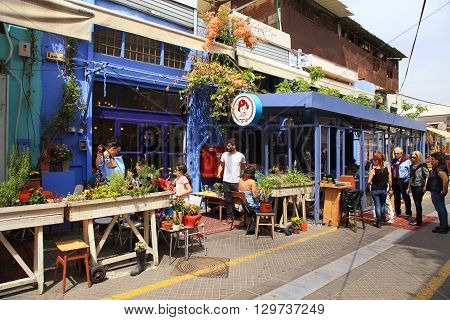 TEL AVIV-YAFO, ISRAEL - APRIL 5, 2016: People at outdoor cafe at popular Jaffa flea market district Tel Aviv, Israel.