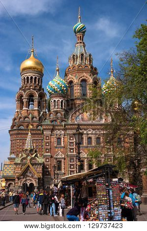 St. Petersburg, Russia - May 14, 2016: Church of the Savior on Spilled Blood. Saint Petersburg, Russia. In the foreground a souvenir shop.