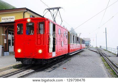 Schynige Platte Switzerland - July 08 2012: Retro passenger train is ready to depart to Interlaken.