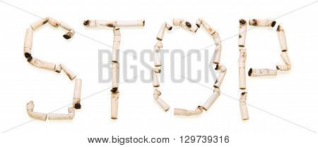 STOP sign Laid isolated from cigarette butts on a white background
