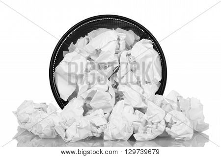 Spill Office basket with crumpled paper isolated on white background