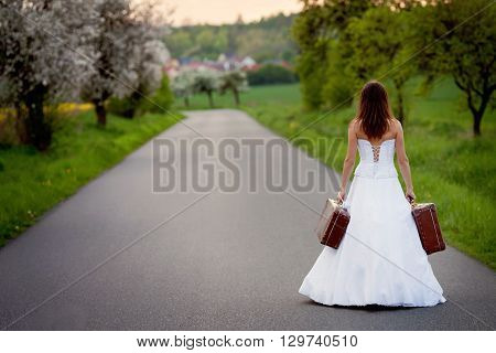 Young Bride On The Road With A Suitcase