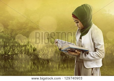 Asian Muslim Woman Reading Koran