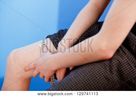 Hands Of Boy Measuring Leg Diameter