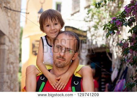 Young Father, Carrying His Toddler Boy On His Neck, Summertime, Child Smiling