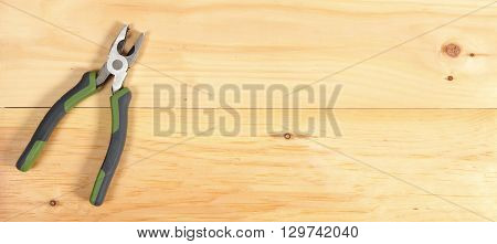 Pliers Wrench On Wooden Background