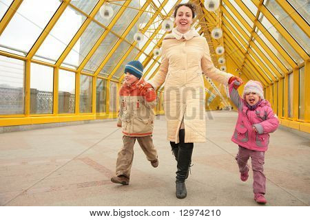 mother with children on footbridge