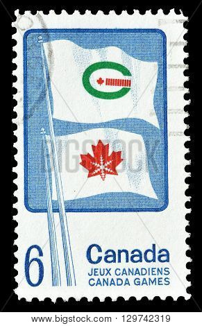 CANADA - CIRCA 1969 : Cancelled postage stamp printed by Canada, that shows Flags of Canada winter and summer games.