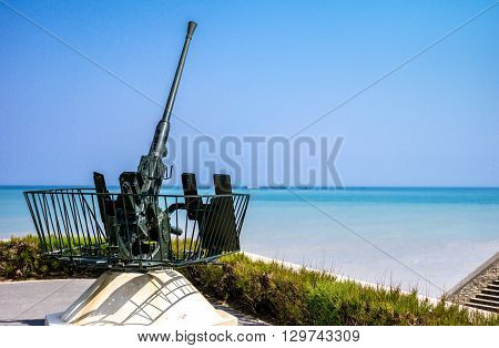 Ouistreham France - May 232012: Normandy an old anti-aircraft weapon in the places of the second World War lending.