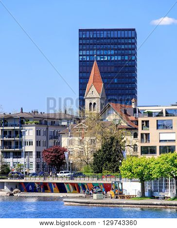 Zug, Switzerland - 6 May, 2016: view on the city of Zug from Lake Zug. The city of Zug is the capital of the Swiss canton of Zug. Lake Zug (German: Zugersee) is a lake in central Switzerland situated between Lake Lucerne and Lake Zurich.
