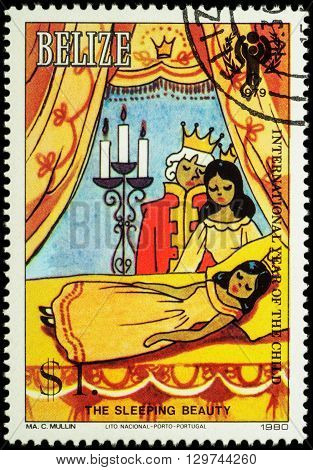MOSCOW RUSSIA - MAY 14 2016: A stamp printed in Belize shows King Queen and sleeping princess - a scene from the fairy tale