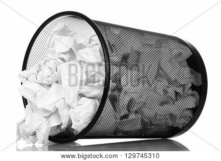 office basket dropping out of her crumpled paper isolated on white background.