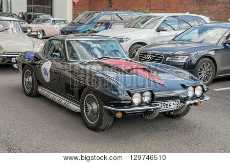 Moscow Russia - April 24 2016: Retro cars rally named after Ingosstrakh Exclusive Classic Day. Chevrolet Corvette Sting Ray Convertible.