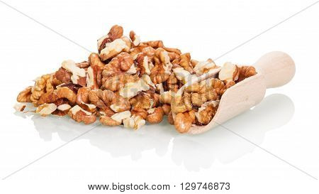 A bunch and a wooden scoop with shelled walnuts isolated on white background.