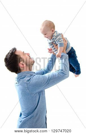 Father raise his new born baby boy on his hands on white