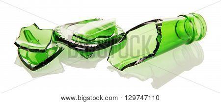 Shards of green glass bottles isolated on white background.