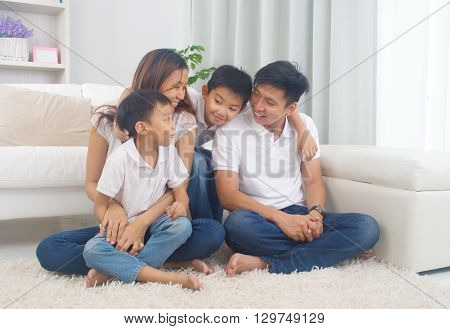 Indoor portrait of a happy asian family