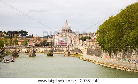 ROME, ITALY - APRIL 8, 2016:  St Peter's basilica in Vatican, river Tiber view and Roma'n bridge