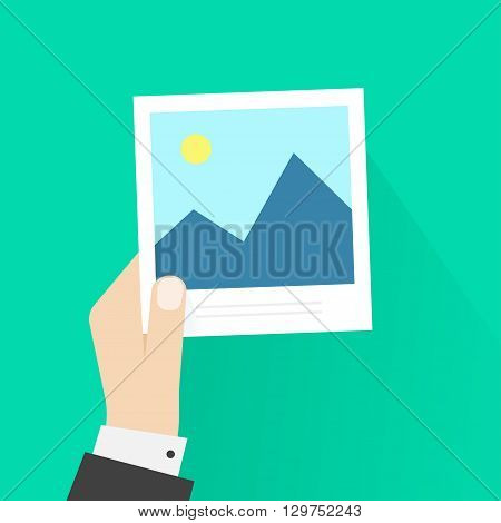 Hand holding photo frame vector illustration, photo card in photographer man hand, cartoon flat style with shadow, postcard, modern design isolated on green background