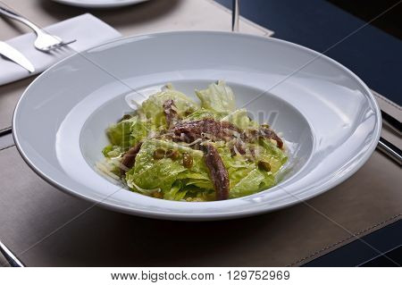 Anchovy salad with cheese and lettuce gourmet plate