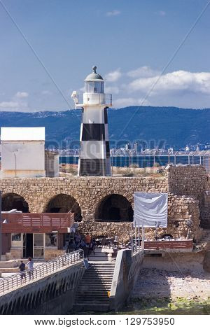 Lighthouse on the waterfront and a fragment of the fortress wall in Old Acre