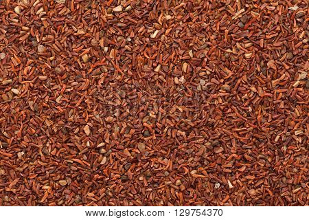 Organic Red Mahogany or Eucalyptus (eucalyptus pellita) seeds. Macro closeup background texture. Top View.