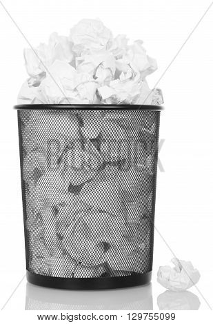 Overflowing metal trash bin from paper isolated on white background.