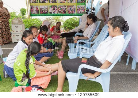 Yala THAILAND - February 15 : Foot massage service Unidentifiedt student sgets The practice of massage In university. with Thai traditional techniques at school When February 15 2016