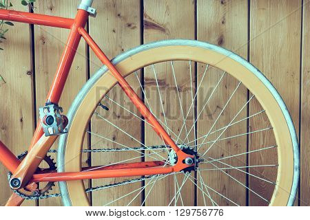 fixed gear bicycle parked with wood wall close up image part of bicycle