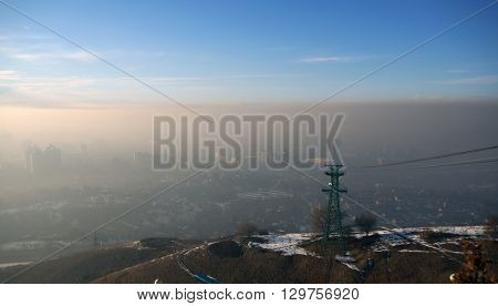 ALMATY, KAZAKHSTAN - January 20, 2016: funicular with tourists and view of the foggy city of Almaty, Kazakhstan