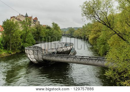 GRAZ,AUSTRIA- APRIL 16: The artificial island on the Mur river in Graz on APRIL 16, 2016 in spring time.