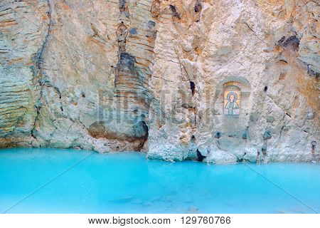 natural underground karst mineral lake Proval with pure blue water and icon of Mashuk mountain in Pyatigorsk Northern Caucasus Russia