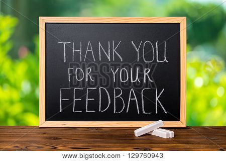 Handwriting Text Thank You For Your Feedback Is Written In Chalkboard On Green Light Background And