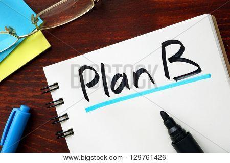 Plan B sign written in a notepad.