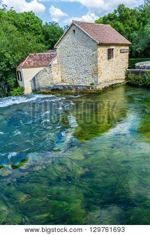 Krka national park Croatia - May 05 2016: historic buiding by rapids