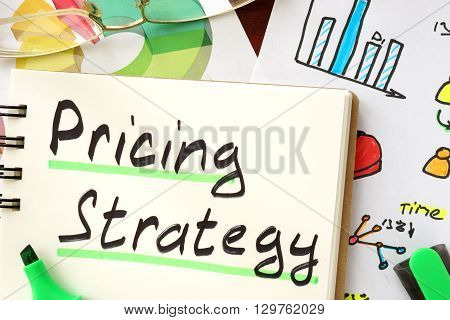 Pricing strategy sign written in a notepad.