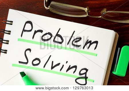 Problem solving sign written in a notepad.