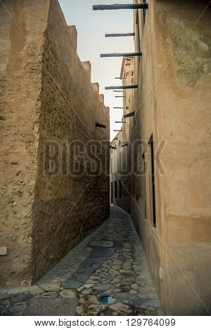 A narrow passage of an old arabic village. Ancient middle eastern architecture.