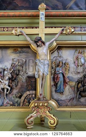 ZAGREB, CROATIA - MAY 28: Cross on the altar in the Basilica of the Sacred Heart of Jesus in Zagreb, Croatia on September 14, 2015