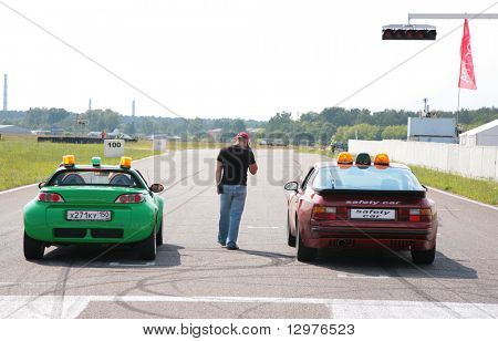 "MOSCOW - JUNE 22: Two cars on line on The second stage of the Championship of Russia June 22, 2008 in autodrome ""Miachkovo"", Moscow."
