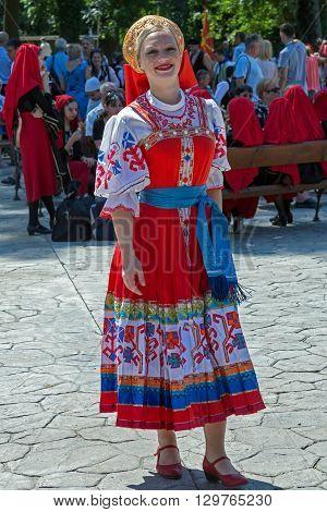 ROMANIA TIMISOARA - JULY 12 2015: Unidentified young Ukrainian girl in traditional costume present at a international folk dance festivalduring