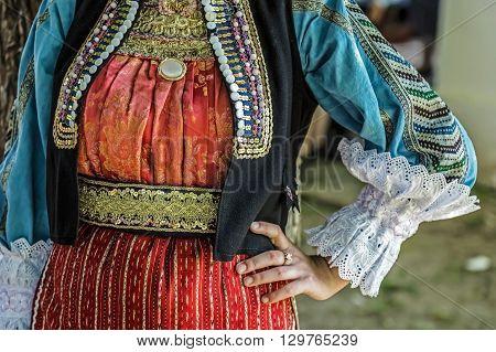 Old traditional Ukrainian folk costume for women.Detail.