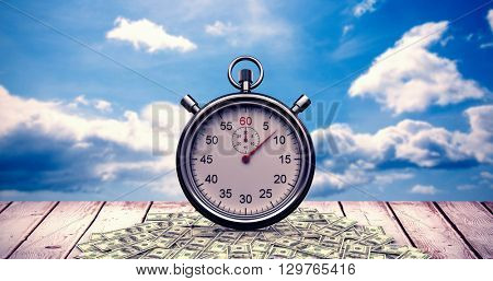Stopwatch over white background against blue sky