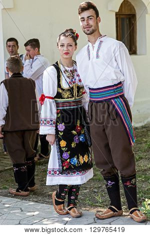 ROMANIA TIMISOARA - JULY 12 2015: Unidentified youths from Serbia in traditional specific costumes attended at a international folk dance festivalduring