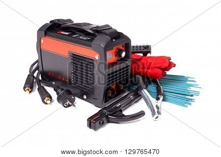 Inverter welding machine, welding equipment, isolated on a white background, leather gloves, welding electrodes, high-voltage wires with clips, set of accessories for arc welding.