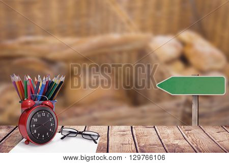 School supplies against baskets with breads freshly baked and tongs