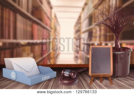 Hammer and gavel against close up of a bookshelf