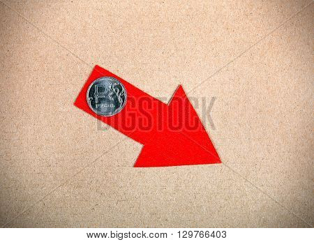 Red Arrow with Russian Ruble on the Cardboard Background