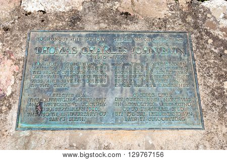 KNYSNA SOUTH AFRICA - MARCH 5 2016: Memorial plaque next to the Diep River bridge for the builder of the Prince Alfred Pass Thomas Charles John Bain