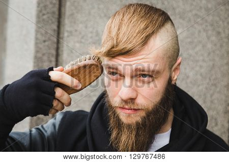 Stylish Man Brushing His Hair